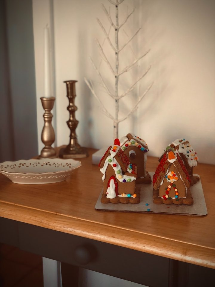Use the make, read, give, see method for Christmas traditions: Make something together, like gingerbread houses!